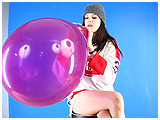 Video clip for sale of Alexxia blowing to burst a 16-inch Qualatex