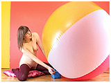 Video clip for sale of Cassie pump-inflating a beach ball