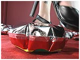 Video clip for sale of Lee foot-popping mylar balloons in heels