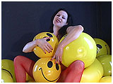 Video clip for sale of Mina enjoying a huge pile of smiley face beachballs