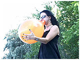 Video clip for sale of Mina blowing to burst outdoors