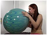 Video clip for sale of Sam blowing to pop a thick-skinned peacock balloon