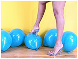 Video clip for sale of Trini reluctantly foot-popping 12-inch balloons