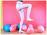 Video clip for sale of Alexxia foot-popping 12-inch balloons
