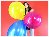Video clip for sale of Ava playing with colourful balloons