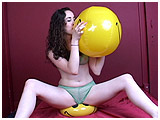 Video clip for sale of Michelle inflating beachballs by mouth