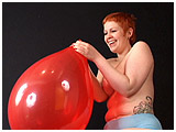 Video clip for sale of Redd blowing to burst balloons