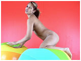 Video clip for sale of Trini bouncing on giant beach balls