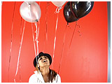 Video clip for sale of Trini playing with helium-filled balloons